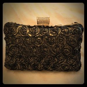 Black and gold hard clutch